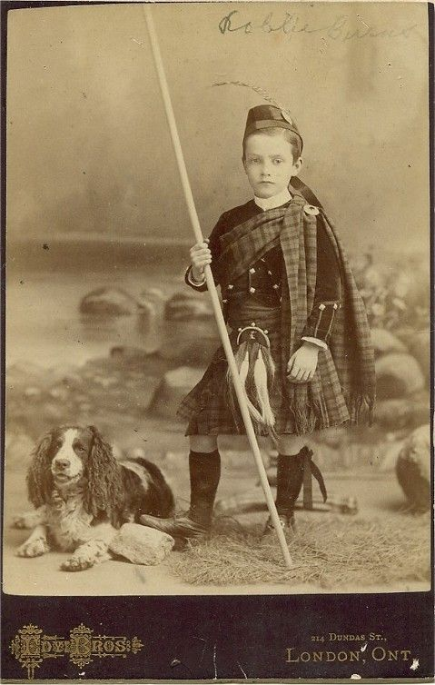 Robbie Burns in his Scottish dress ready for a walk with his dog: