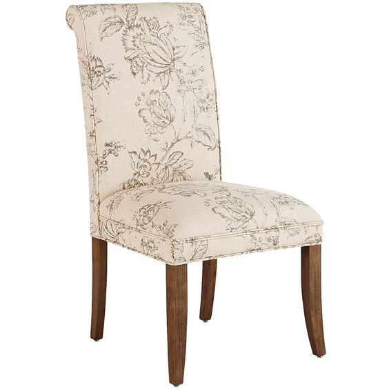 Hand-upholstered in beautiful, linen-blend print, our Angela Deluxe Dining Chair has a tight, self-welted seat and classic rolled back. Durably constructed of a solid wood frame.