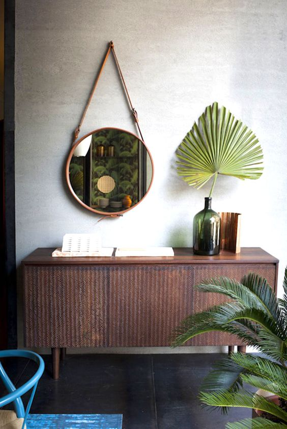 Plant leaf in vintage bottle with hanging round mirror | Amara • Life • Style • Living • |
