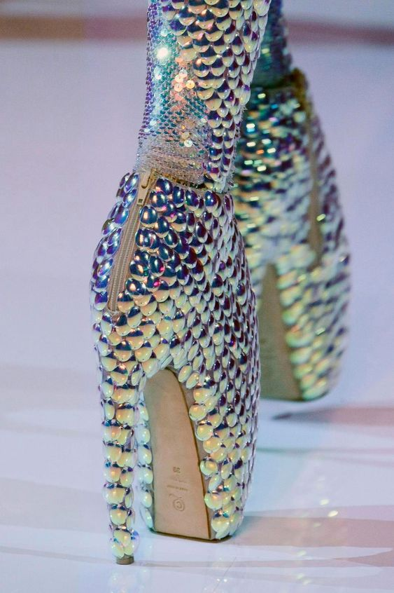 """These Alexander McQueen Shoes are so different and out - there who couldnt love them. The shine of the pebble sort of design gives a fish-skale look to the """"lady gaga"""" heels."""