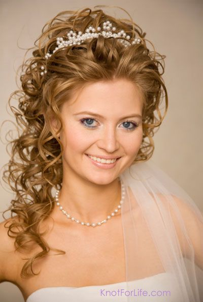Curly wedding hairstyles with tiara and veil