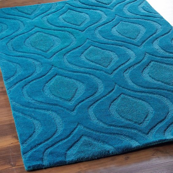 Plush Peacock Diamond Texture Rug Pretty as a peacock with a diamond like pattern of plush wool pile in luscious fashion colors. This sophisticated one color design is rich in texture and modern style for your upscale interiors. Offered in 4 rich colors including; teal Blue, golden Yellow, persimmon Rust and citron Green