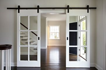 Good idea if you find salvaged french doors that are too tall for the door frame...use barn door hardware