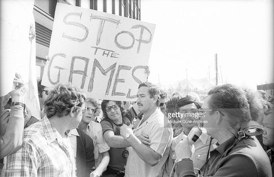 Demonstrators march in support of the Israili Olympic team and demand an end to the Games as 9 surviving members are being held hostage by members of the Black September Organization (a terrorist group afilliated with the Palestine Liberation Organization) on September 5, 1972 in Munich, West Germany.  (Photo by Michael Montfort/Michael Ochs Archives/Getty Images)