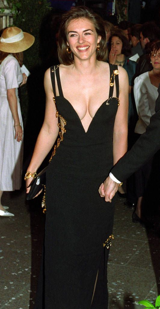 Would Elizabeth Hurley Ever Wear Her Iconic Versace Safety Pin Dress Again Exclusive By Paparazzi Dress E Hurley Dress Liz Hurley Dress Elizabeth Hurley
