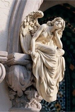 Sitting Angel Sculpture - I love the way she is looking up - as though she is here with us.