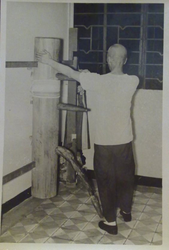 Wing Chun Grandmaster Ip Man practicing on a wooden dummy in 1967.8