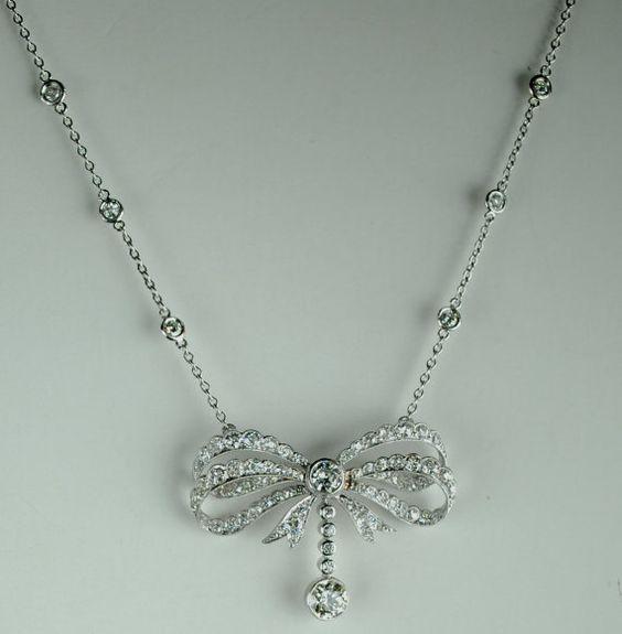 Art Deco Platinum Diamond Bow Pendant 4.25 by greenhilljewelers