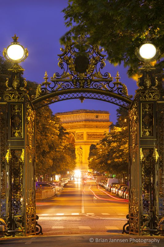 Arc de Triomphe viewed through the entry gate to Parc Monceau, Paris France © Brian Jannsen Photography