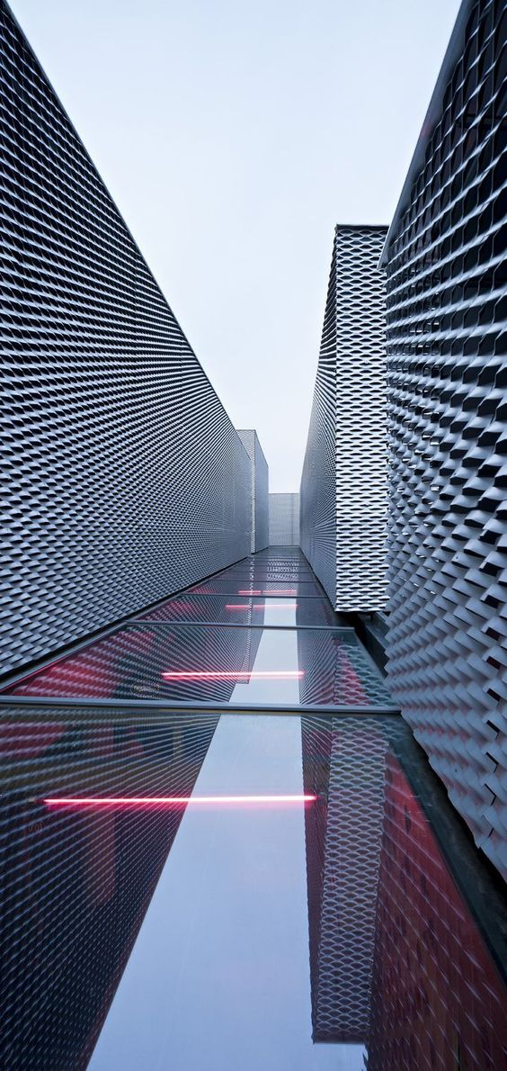 Architecture we like facade metal waves water for Refection facade
