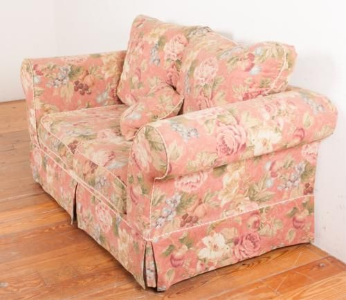 """Ashley Furniture Industries love seat with floral upholstery and oversized back cushions; marked with tag under cushions; measures approximately 38"""" h"""