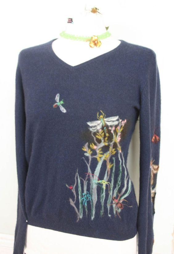 Sweater. Lou Tonkin. Lou mends, patches and decorates old jumpers, using her felting needle and wool to great effect, inspired by the Cornish countryside