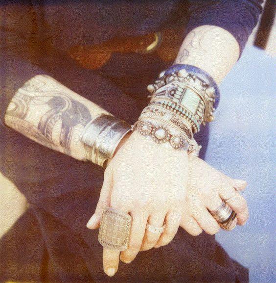 Tattoos + jewellery.