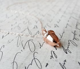 An acorn necklace. Omg, if I could wear Peter Pan's kiss. My single necklace (if it works with the dress) would be this.