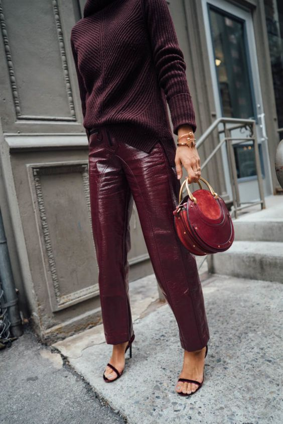 Monochrome burgundy vinyl pants and sweater | Song of Style