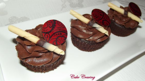 Chocolate mud cupcakes - Rich Mud cupcakes, topped with chocolate orange buttercream and finished with chocolate orange discs with a cocoa butter transfer and chocolate cigarello's...