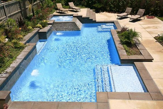 Geometric swimming pool with square tanning ledge life for Pool design with tanning ledge