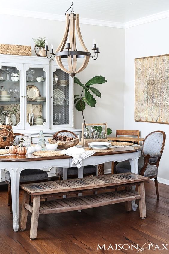 beautiful french dining room with classic french country dining furniture balanced by a rustic bench   http://maisondepax.com