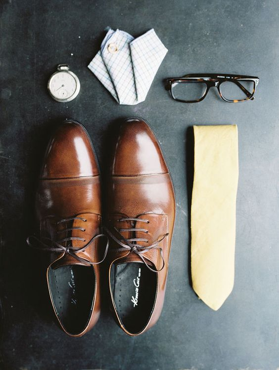 Groom attire, yellow tie and brown leather shoes for an elegant wedding