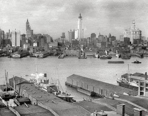 "New York circa 1912. ""Manhattan skyline from Brooklyn."" The Singer Building rises at left along with the Woolworth tower and Municipal Building, both under construction."