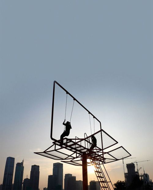 Double Happiness  Architect Didier Faustino created this epic swing set out of a converted advertising billboard for the Shenzhen-Hong Kong Bi-City Biennial of Urbanism and Architecture. Double Happiness responds to the society of materialism where individual desires seem to be prevailing over all. This nomad piece of urban furniture allows the reactivation of different public spaces and enables inhabitants to reappropriate fragments of their city.