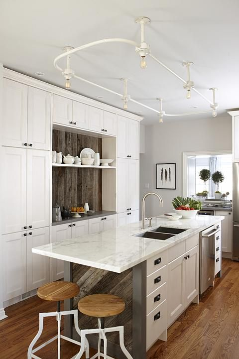 Modern country kitchen with black,white, and grey. Industrial style ceiling lights and reclaimed wood accent on island. #moderncountry #kitchen #blackandwhite