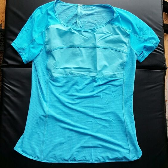 Lululemon Top Size 6 Excellent Condition...Has a slit on the back on the top... lululemon athletica Tops