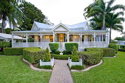 Restoring the old girl a study in the classics a stunning for Classic queenslander house