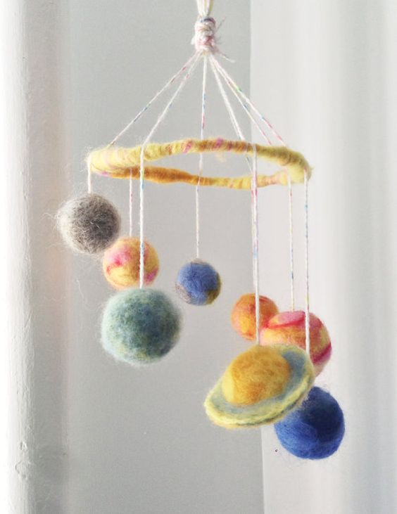 felted solar system mobile! Aww, I could totally make this!