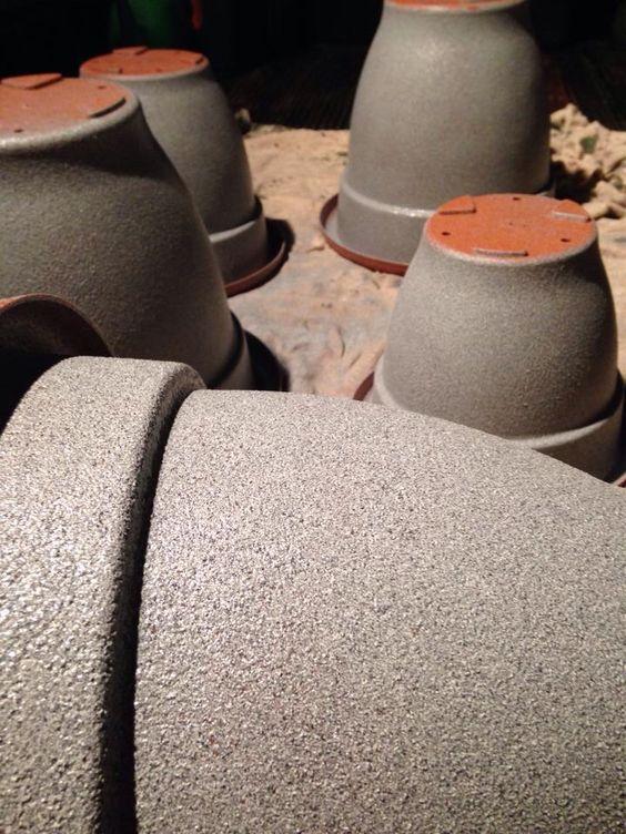 Spray painting plastic pots to look like stone!