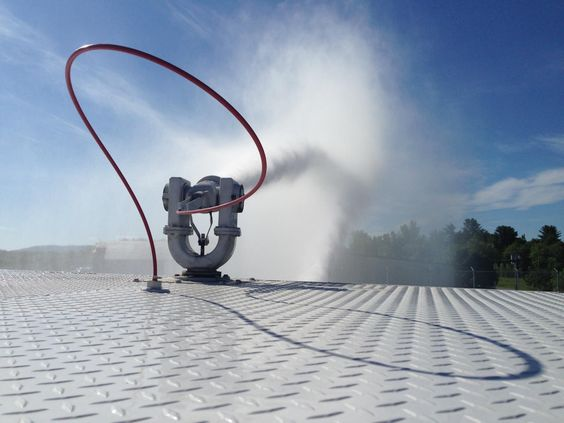 One of the things I try to do when taking photos is to get a different perspective.  Perched atop the Aircraft Rescue and Firefighting (ARFF) vehicle I snapped this photo of water spraying from the roof turret.