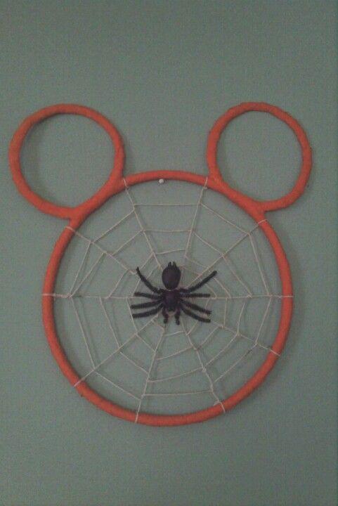 DIY decor PVC pipe string and orange streamer Halloween Disney.