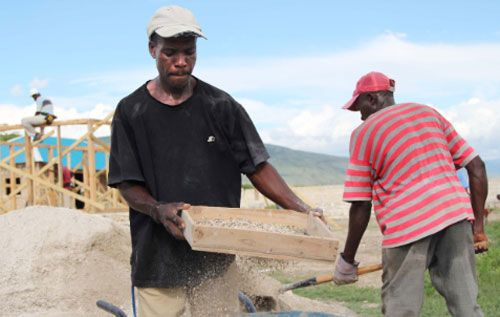 First mobile phone cash transfers facilitate UN-backed home rebuilding.