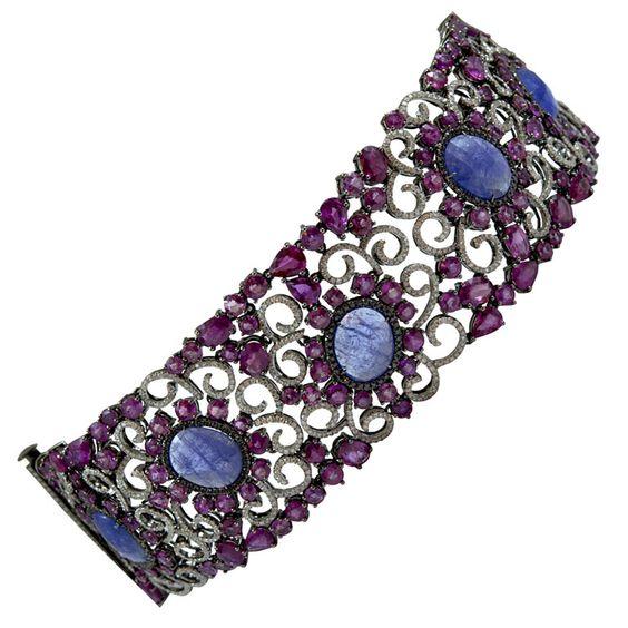 Wide Ruby Diamond Tanzanite Bracelet | From a unique collection of vintage modern bracelets at http://www.1stdibs.com/jewelry/bracelets/modern-bracelets/