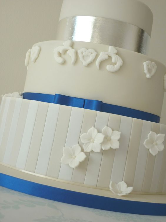 Ivory & Royal Blue Wedding Cake - In terms of design, the ...