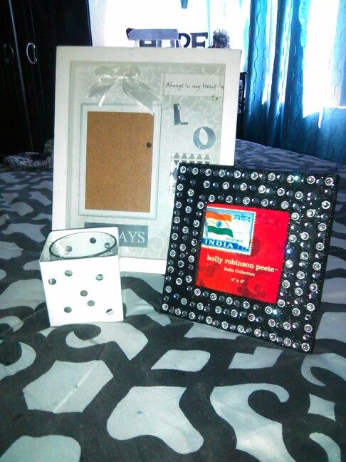 Another $5.00 Goodwill Challenge...$2.00 (Holly Robinson) bling picture frame still had its original price on the back..$6.99 from Home Goods...the Nate Berkus candle holder $1.00..and the white picture frame $2.00...I luv shopping at Goodwill and other Thrift Stores for home decor finds