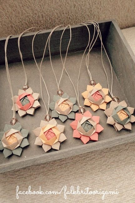 These bookmarks are made from lovely paper flowers, beads, and cord.  |  Falk Brito Origami