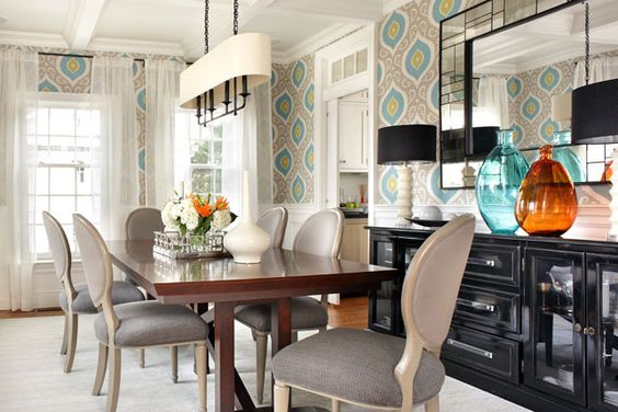 Dining room, arteriors chandelier, black lacquer buffet, medallion wallpaper, turquoise wallpaper, orange clear glass vase, gray dining chairs, vanguard farmhouse dining table, antique bronze chandelier, oval chandelier