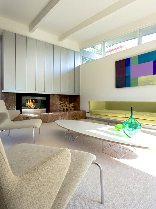 #Groovy yet clean living room design with a #modern #fireplace and stacked #firewood. Love those lounge #chairs and #sofa!