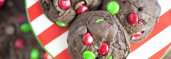 I love big, fat, thick, and chewy cookies and these are no exception! I loaded these chocolate cookies up with extra chocolate chips and red and green m&m candies for a festive touch! These sim...