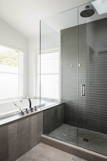 If you opt for medium or dark #gray wall and floor tiles, try selecting tiles of different sizes, shapes and shades to keep them from looking monolithic and overbearing #bathroom