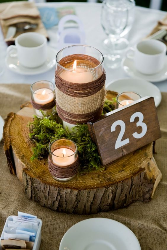 rustic moss wedding table numbers / http://www.deerpearlflowers.com/moss-decor-ideas-for-a-nature-wedding/3/