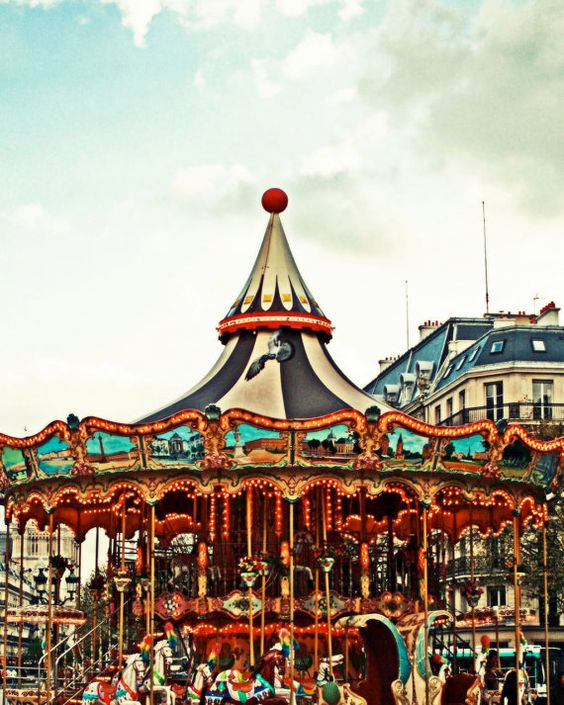 Paris Carousel  LOCATION: Paris, France  I love carousels and I love Paris, that ferris wheel by the way is beautiful!