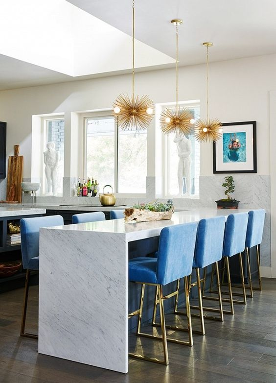 Open plan kitchen with a marble island doubling as a dining space