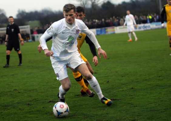 AFC Fylde survived a late-late show from second placed Barrow to hold on to a slender 2-1 lead to go three points clear of the Bluebirds at the top of the Vanarama Conference North with a game in hand.