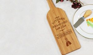 Personalized wine-bottle-shaped cutting board makes an ideal gift for wine lovers and can be used for serving appetizers and cheese plates