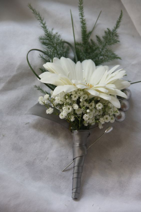 Gerber daisy boutonniere, but with blue accents instead of baby's breath.