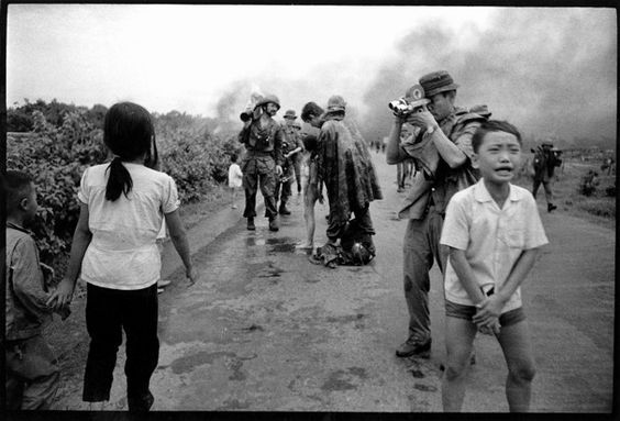 """David Burnett, then a 25-year-old photojournalist, captured this image of the aftermath of the napalm attack at Trang Bang in Vietnam in summer 1972. """"It was real life, unfolding at the pace of life,"""" he writes.  David Burnett / Contact Press Images:"""