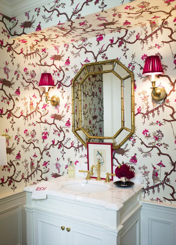 The vanity is pretty ordinary but the mirror and wallpaper make the room sing!