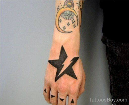 Tattoosformen Star Tattoo On Hand Star Tattoos Hand Tattoos
